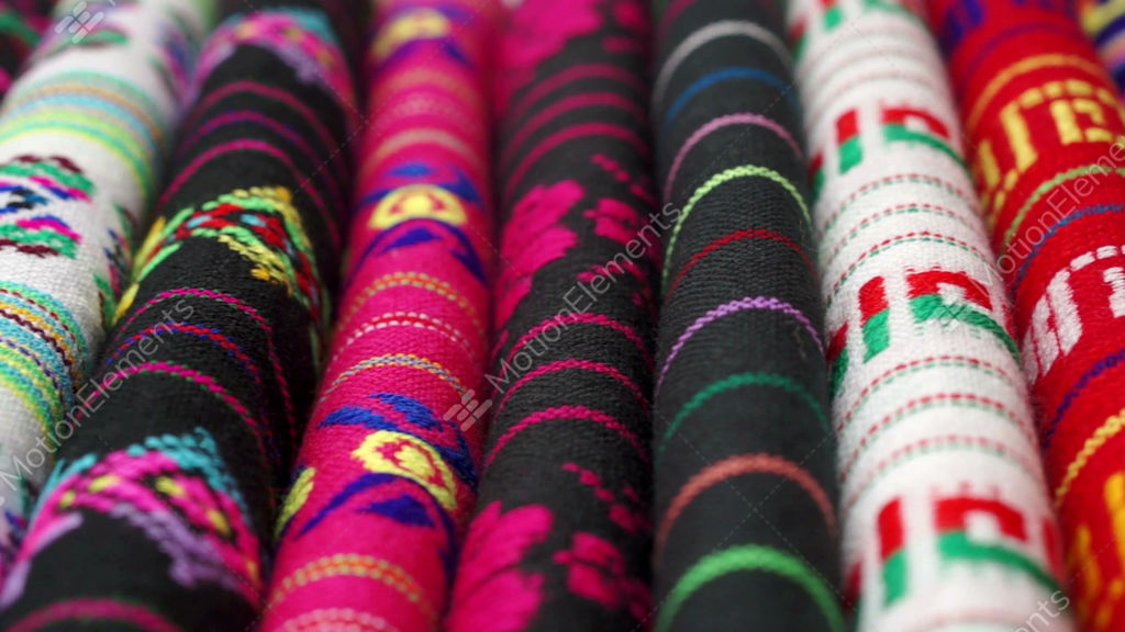 Dolly Across Traditional Mexican Fabrics GIF